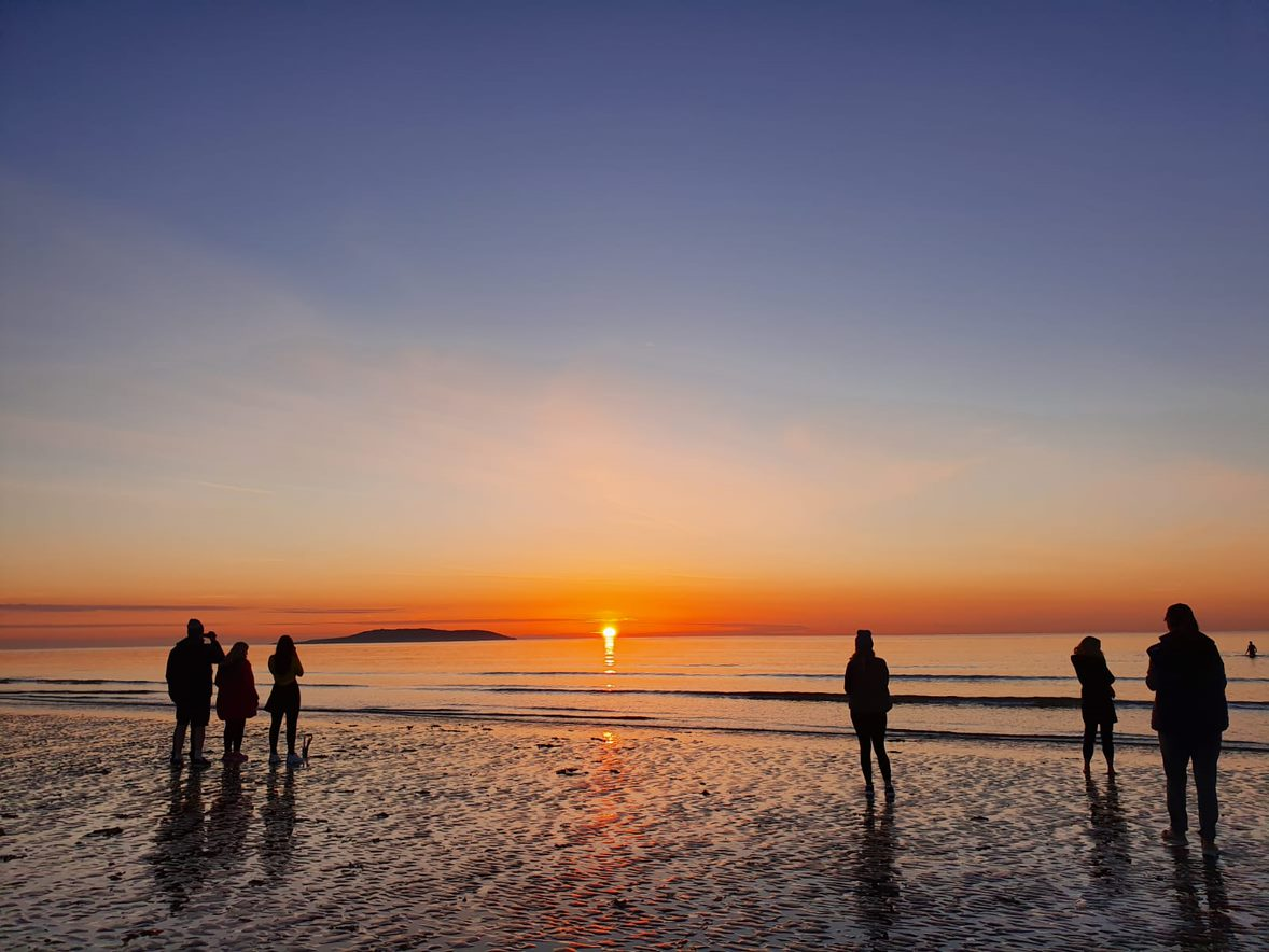 Sunrise at a beach with people