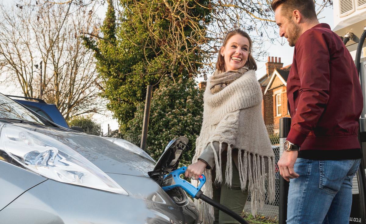 Woman charging EV